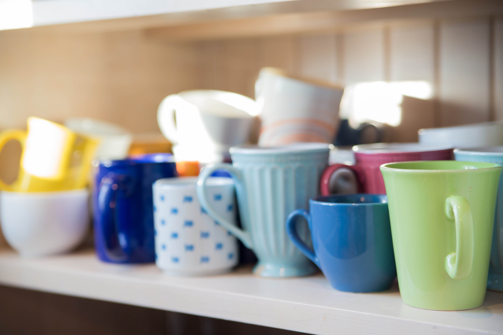 Many mugs on shelf are clean and dry