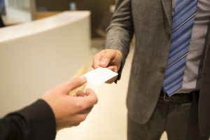 Businessmen hands businessperson suits office lobby