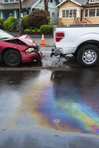 Iridescent oil spill caused by a traffic accident